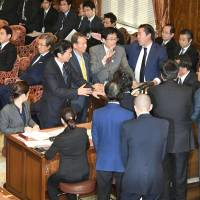 Opposition lawmakers protest at the special Lower House panel on the Trans-Pacific Partnership pact on Friday before a bill was approved to ratify the free trade agreement. | KYODO