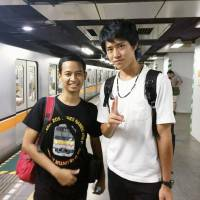 Syahri Rochmat (left), a 24-year-old railway worker from Indonesia, and Shota Noda, a 21-year-old college student from Yokohama, are all smiles in Japan in August. | COURTESY OF SYAHRI ROCHMAT / VIA KYODO
