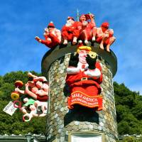Figures of newsmakers, including Donald Trump and Yuriko Koike, are exhibited for Christmas on the roof of the Uroko no Ie museum in the historic Kitano district of Kobe Friday. | KYODO