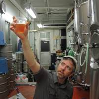 Liquid gold: Jason Koehler, founding partner of DevilCraft Craft Beer & Pizza, inspects a sample of a new brew. | DAVEY YOUNG
