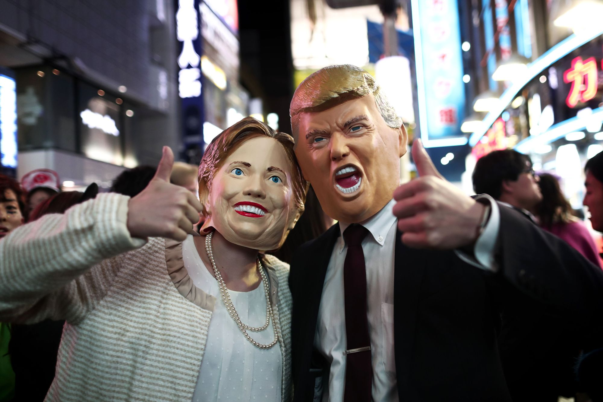 Boo: People wear costumes of U.S. presidential candidates Hillary Clinton and Donald Trump as they take part in a Halloween parade in Tokyo on Oct. 29.   BEHROUZ MEHRI / AFP-JIJI
