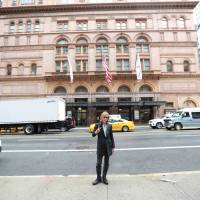 Renaissance man: Yoshiki stands in front of Carnegie Hall in New York City. The musician will play two concerts at the storied venue on Jan. 12 and 13, 2017.