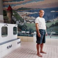 Teruo Shimada stands in a bathing area at Akebono-yu in Edogawa Ward. | DAN SZPARA