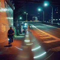 Silent streets: A man cycles along an empty sidewalk on the outskirts of Shibuya. | ANDREW CURRY