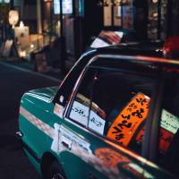 A taxi glides along a Shibuya backstreet. | ANDREW CURRY