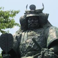 Fearsome face: A towering statue of Takeda Shingen stands in front of Kofu Station. | COURTESY OF KOFU TOURIST ASSOCIATION