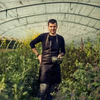 Green thumb: Belgian chef Gert De Mangeleer stands in the greenhouse that hosts many of the ingredients he uses in the meals served at Hertog Jan.