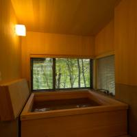 Winter soak: A wooden bath looks out at natural Fukushima forest. | COURTESY OF HOTELLI AALTO