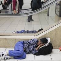 In poverty?: Some Japanese people believe a person isn't really poor unless they wear shabby clothes and live on the street. | ISTOCK