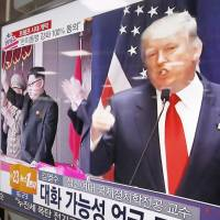 Asian insecurity: A TV screen at a railway station in Seoul  shows pictures of U.S. President-elect Donald Trump and North Korean leader Kim Jong Un. | AHN YOUNG-JOON / AP