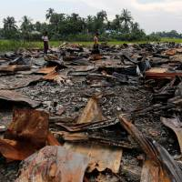 Scorched earth: The ruins of a market that was set on fire are seen at a Rohingya village outside Maugndaw in Rakhine state, Myanmar.   REUTERS