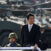 Security concerns: Japanese Prime Minister Shinzo Abe reviewed Japanese Self-Defence Force (SDF) troops at Asaka Base in October. | Kim Kyung-Hoon / REUTERS