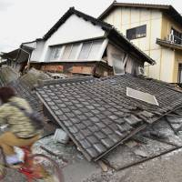 Crushed: The upper level of a house in Kumamoto flattens the floor below. | KYODO