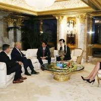 Meeting the new guy: Prime Minister Shinzo Abe (third from the left) meets with U.S. President-elect Donald Trump (second from the left) in New York, as Trump's daughter Ivanka Trump (right) looks on. | AFP-JIJI