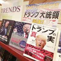 Fifteen books in Japanese about U.S. President-elect Donald Trump are displayed on a special shelf set up at the Yaesu Book Center in Tokyo in the wake of the Republican nominee's surprise triumph last week. | AP