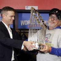 Late-night rain delay helps Cubs capture elusive title