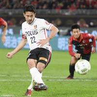 Urawa's Yuki Abe scores a 57th-minute penalty against Kashima in the first leg of the J. League Championship final on Tuesday. The Reds won 1-0. | KYODO
