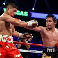 Pacquiao pummels Vargas with Mayweather watching