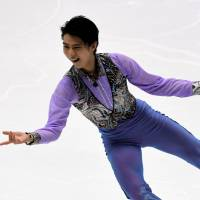 Yuzuru Hanyu performs his short program at the NHK Trophy on Friday in Sapporo. Hanyu received a top score of 103.89 points, putting him in firm control in the men's singles competition at Makomanai Arena. | AFP-JIJI