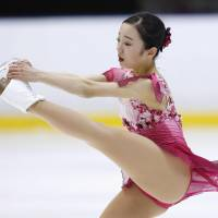 World junior champion Marin Honda was second after the short program but settled for third with 176.23 points. | KYODO