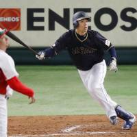 Japan's Shogo Akiyama belts a seventh-inning hit against Mexico's Jose Oyervides on Friday at Tokyo Dome. Akiyama led Japan with four RBIs in Japan's 11-4 victory over Mexico. | KYODO