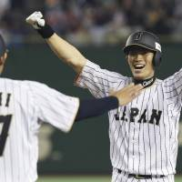 Shota Ono (right) celebrates after his game-winning hit in the 10th inning on Saturday. | AP