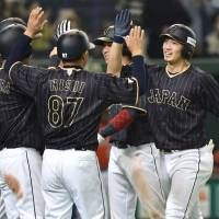 Suzuki sends Japan to victory with 10th-inning grand slam