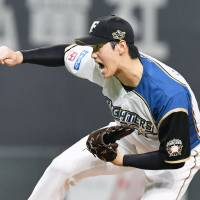 The Fighters' Shohei Otani struck out 174 batters as a pitcher while also hitting 22 home runs at the plate. | KYODO