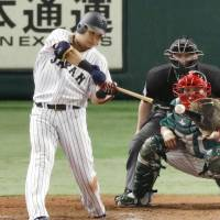 Japan's Yoshitomo Tsutsugo hits an RBI double in the fifth inning against Mexico on Thursday night. | KYODO