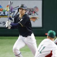 Designated hitter Shohei Otani, who batted third for Japan, finished with two hits on Friday. | KYODO
