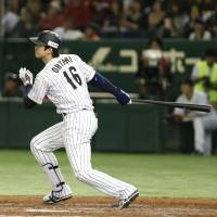 Japan's Shohei Otani hits a home run during the fifth inning of his team's win over the Netherlands on Saturday. | AP