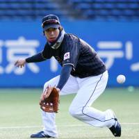Samurai Japan's Tetsuto Yamada fields a ball during team practice at QVC Marine Field in Chiba on Monday. | KYODO