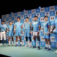 University of Tsukuba athletes pose for photos in their new uniforms during a news conference on Tuesday. | KAZ NAGATSUKA