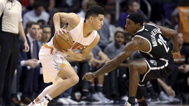 Booker has Suns on rise following a season to forget