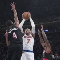 Porzingis, Rose carry torch for Knicks in victory