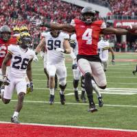 Ohio St. tops Michigan in double-OT classic