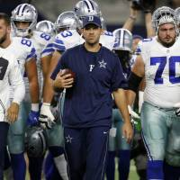 Romo practicing, but playing status unclear