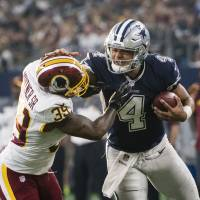 Cowboys beat Redskins to extend winning streak to 10