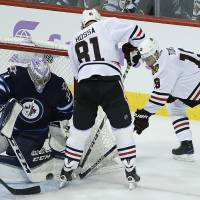Hellebuyck gets first shutout as Jets beat division-leading Blackhawks