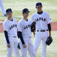 Samurai Japan pitchers Shota Takeda (left), Shohei Otani (center) and Shintaro Fujinami take part in a team practice in Chiba on Monday. | KYODO