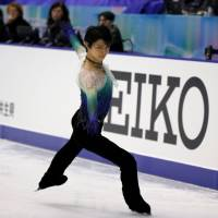 Olympic champion Yuzuru Hanyu glides across the ice during the men's free skate at the NHK Trophy on Saturday in Sapporo. Hanyu claimed the top prize with 301.47 points. | REUTERS