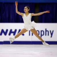 Satoko Miyahara soars through the air during her free program at the NHK Trophy on Saturday. Miyahara finished in second place with 198.00 points. | REUTERS
