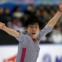 Keiji Tanaka placed third in the men's singles program with 248.44 points. | REUTERS