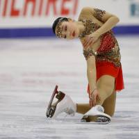Wakaba Higuchi competes in the women's free skate on Saturday. Higuchi finished fourth. | REUTERS