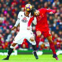 Liverpool thrashes Watford to move top