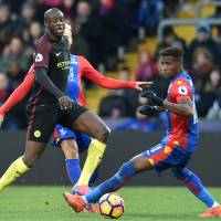 Toure returns to lift City past Palace