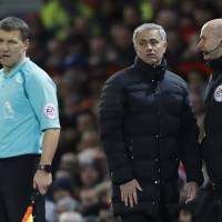 Mourinho sent off on bad day for United