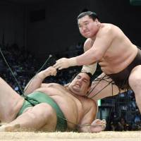 Yokozuna Hakuho defeats Kaisei for his 1,000th career win on Tuesday at the Kyushu Grand Sumo Tournament in Fukuoka. | KYODO