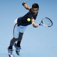 Djokovic tops Raonic to reach semis