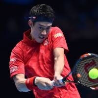 Nishikori advances despite loss